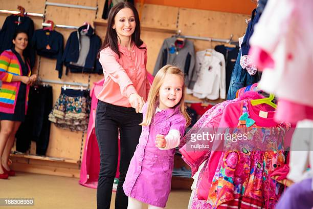 mother and daughter at children's store
