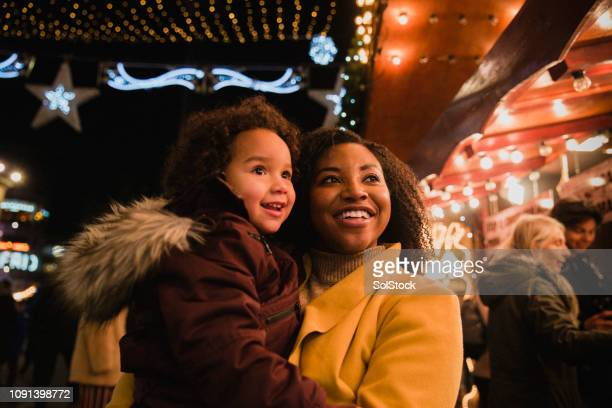 mother and daughter at christmas markets - daughter photos stock photos and pictures