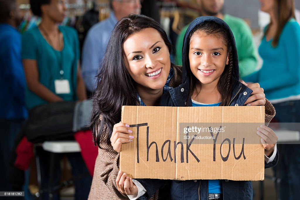Mother and daughter at coat drive : Stock Photo