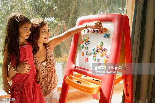 mother and daughter at easel