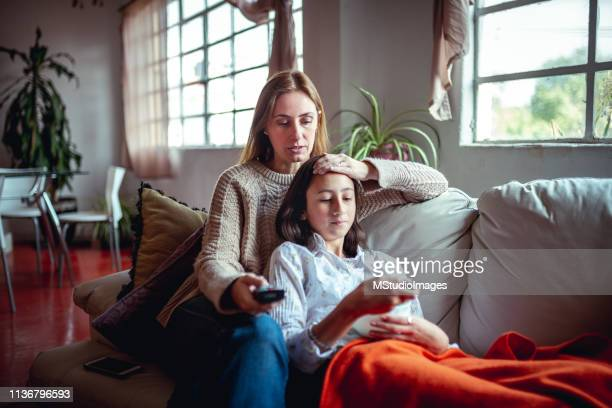 mother and daughter at home. - illness stock pictures, royalty-free photos & images
