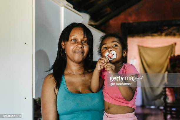 mother and daughter at home - pardo brazilian stock pictures, royalty-free photos & images