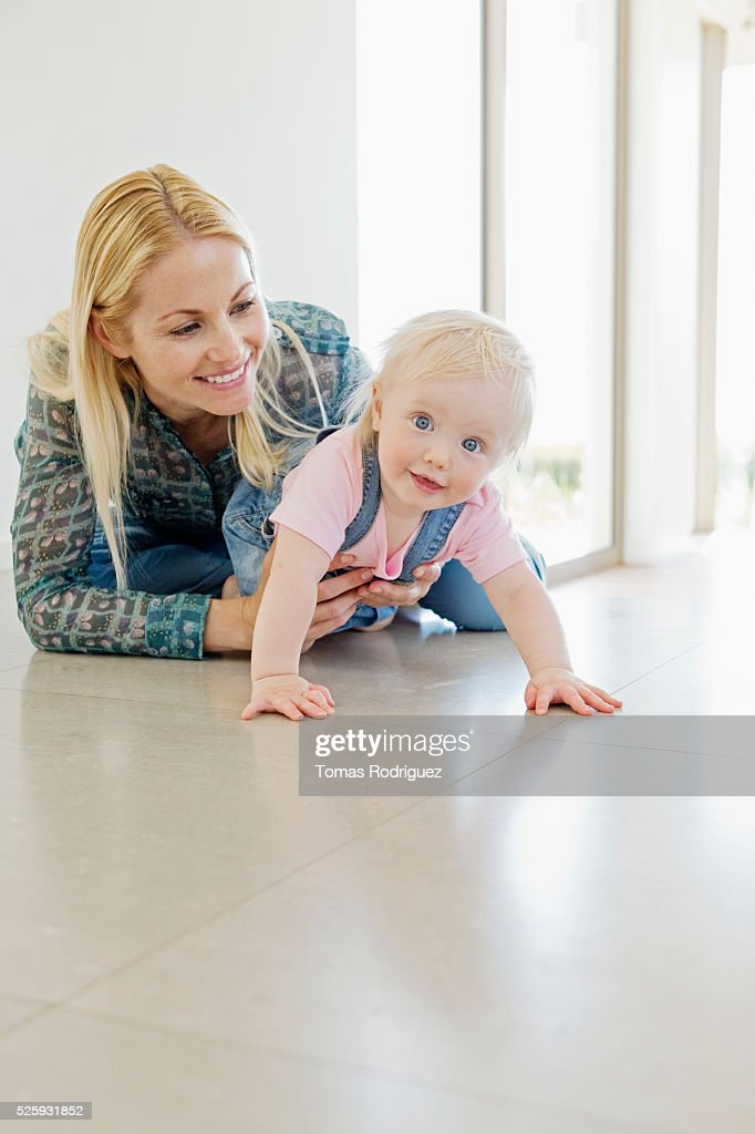 Mother and daughter (12-23 months) at home : Stock Photo
