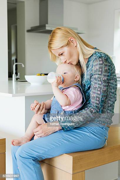 Mother and daughter (12-23 months) at home