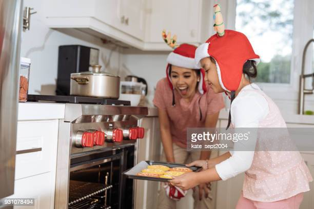 mother and daughter at home - filipino christmas family stock pictures, royalty-free photos & images