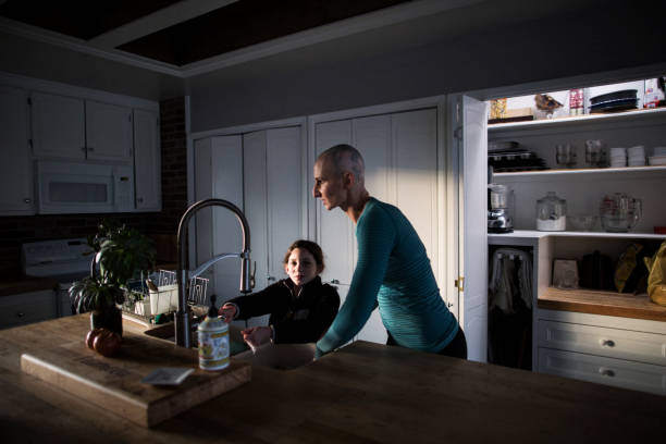 mother and daughter at kitchen sink