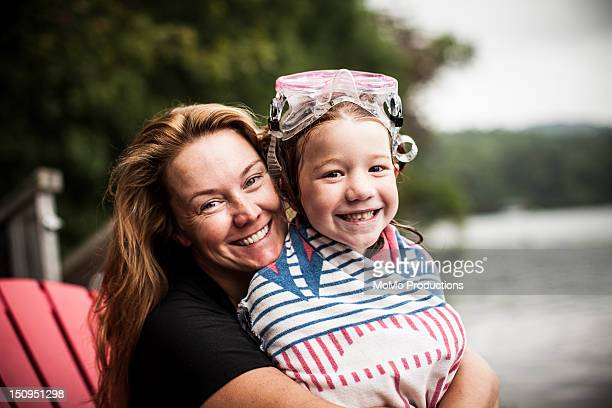 mother and daughter at lake - portrait - mother daughter towel stock photos and pictures