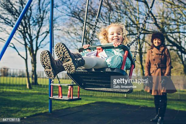 mother and daughter at the park together - britain playgrounds stock pictures, royalty-free photos & images