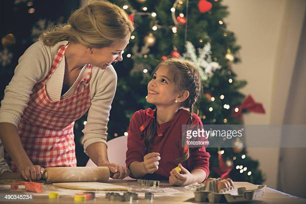 Mother and daughter baking cookies for Christmas
