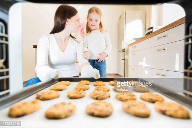 mother and daughter baking cookies