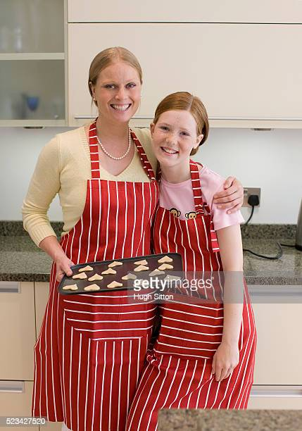 mother and daughter baking cookies - hugh sitton stock pictures, royalty-free photos & images