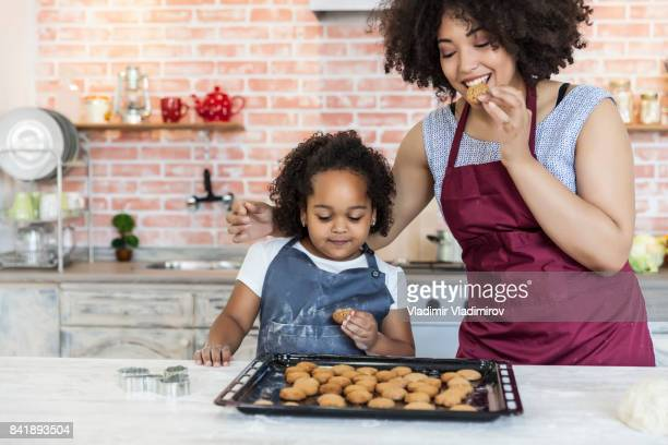 Mother and daughter baking homemade biscuits