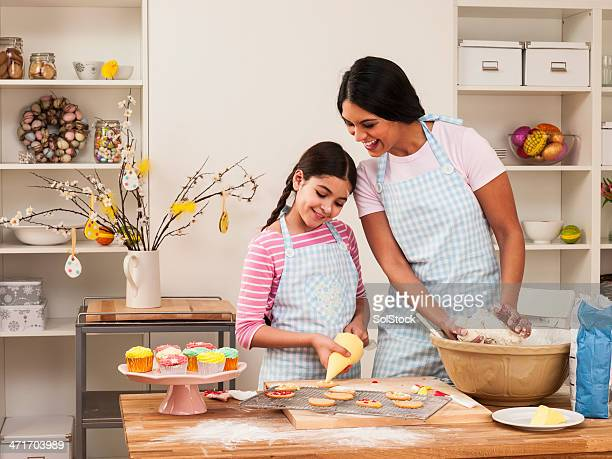 mother and daughter baking - happy easter mom stock pictures, royalty-free photos & images