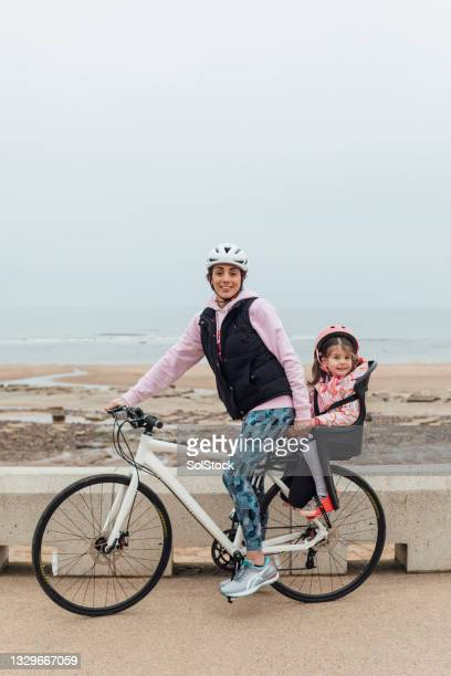 mother and daughter bonding bike ride - headwear stock pictures, royalty-free photos & images