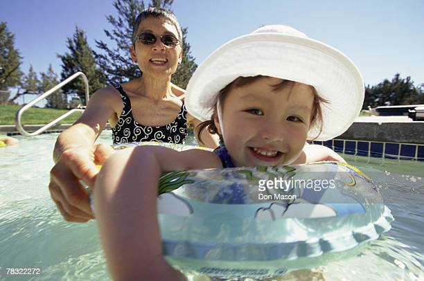 Mother and daughter bonding in a swimming pool