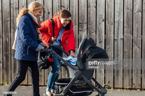 mother and daughter bonding - carriage stock pictures, royalty-free photos & images