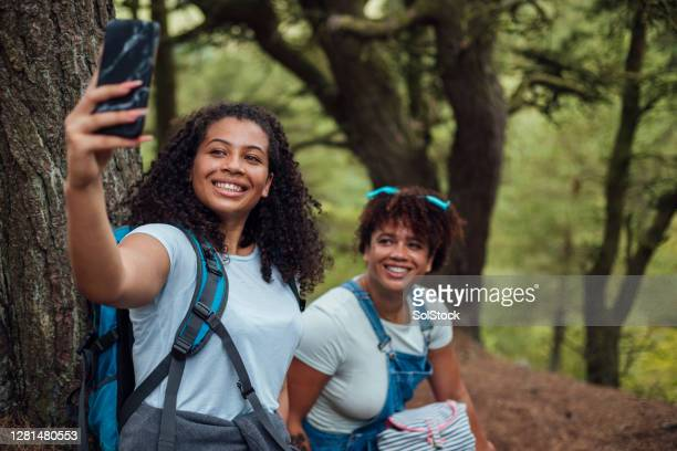 mother and daughter bonding time - teenage girls stock pictures, royalty-free photos & images