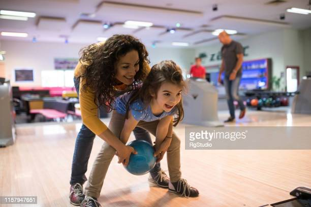 mother and daughter bowling - bowling stock pictures, royalty-free photos & images