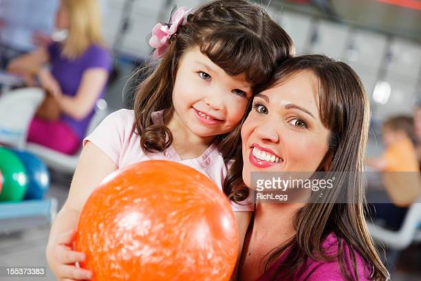 Mother and Daughter Bowling