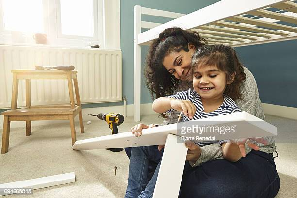 Mother and Daughter building furniture