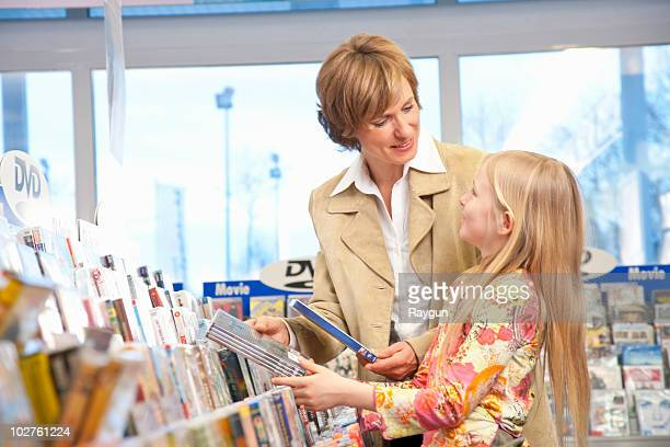 Mother and daughter buying DVDs
