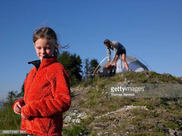 mother and daughter (9-11) camping (focus on daughter) - fleecejas stockfoto's en -beelden