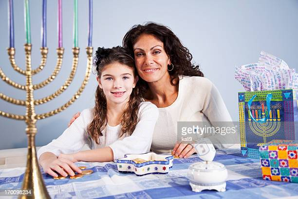 Mother and daughter celebrating Hanukkah