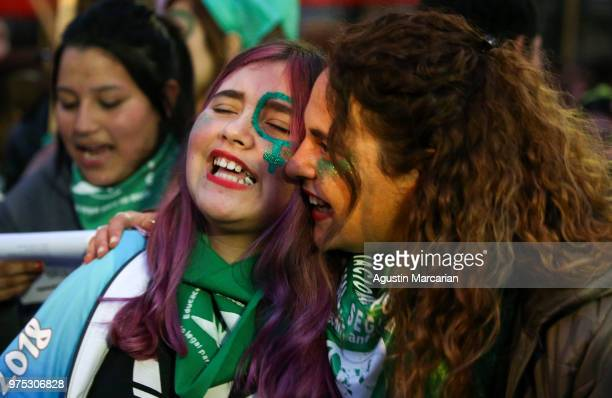 A mother and daughter chant pro abortion slogans during a rally to demand legal and free abortion at Congressional Plaza on June 13 2018 in Buenos...