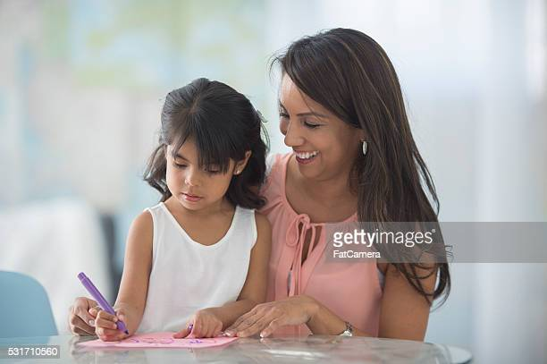Mother and Daughter Coloring Together