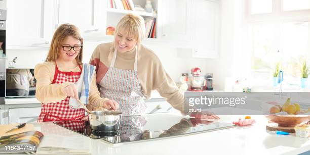mother and daughter cooking fun - electric stove burner stock pictures, royalty-free photos & images