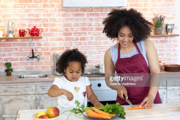 Mother and daughter cooking together
