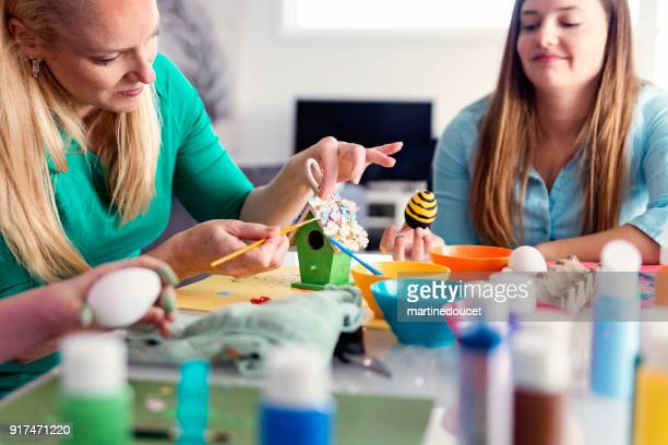 """mother and daughter crafting easter decorations at home. - """"martine doucet"""" or martinedoucet stock pictures, royalty-free photos & images"""