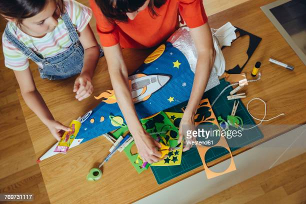 mother and daughter creating her space themed school cone at home - 出来事の発生 ストックフォトと画像