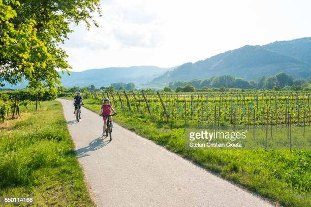 Mother and daughter cycling in Austria