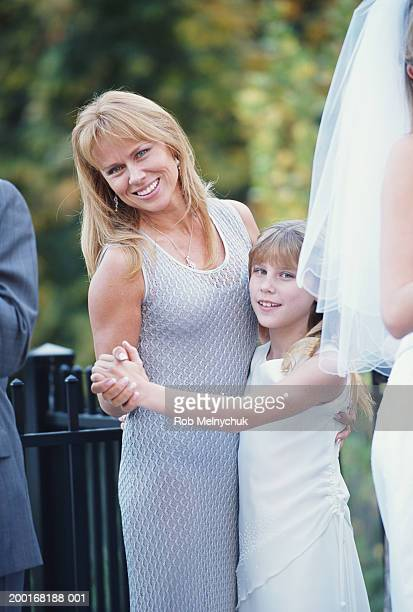 Mother and daughter (8-10) dancing at wedding reception, portrait