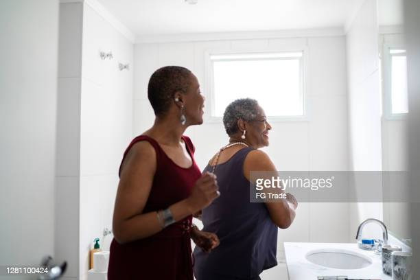 mother and daughter dancing in the bathroom - shaved stock pictures, royalty-free photos & images