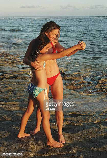 Filipino girls in bikinis stock photos and pictures getty images mother and daughter 9 11 dancing on rocks at beach thecheapjerseys Choice Image