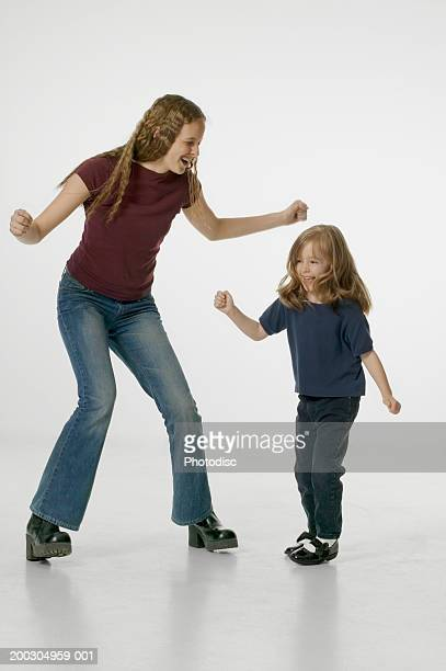 Mother and daughter (4-5) dancing