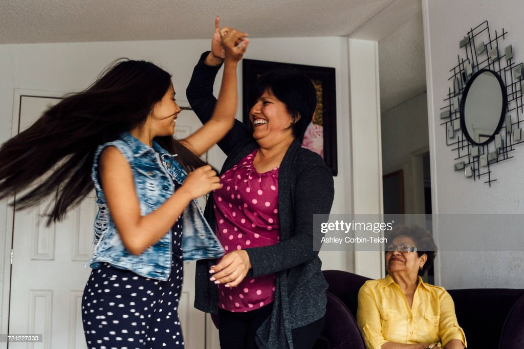 Mother and daughter dancing : Stock Photo