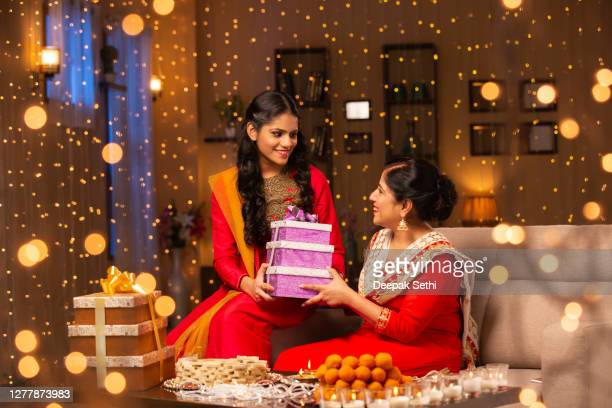 mother and daughter diwali celebrate - stock photo - diwali stock pictures, royalty-free photos & images