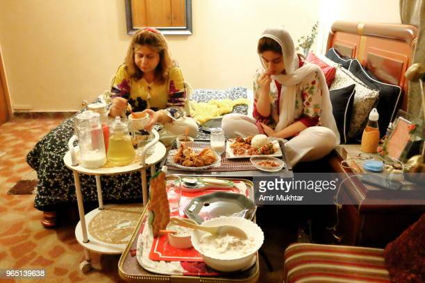 Mother and daughter doing aftari or breaking fast in Ramadan in Pakistan