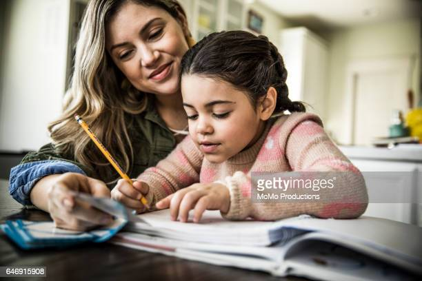 mother and daughter (7 yrs) doing homework - one parent stock pictures, royalty-free photos & images