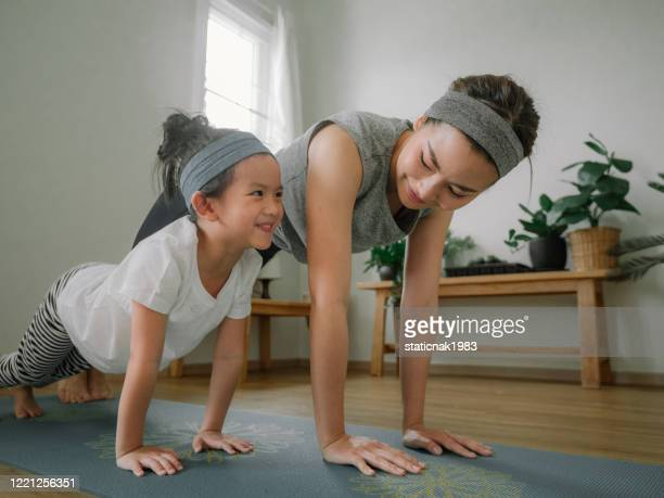 mother and daughter doing yoga - motivation stock pictures, royalty-free photos & images