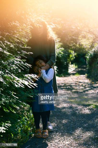 mother and daughter, dramatic portrait - daughters of darkness stock pictures, royalty-free photos & images