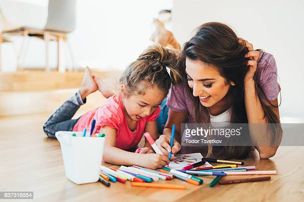 mother and daughter drawing - colouring stock photos and pictures