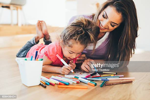 mother and daughter drawing - colouring stock pictures, royalty-free photos & images