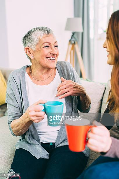Mother and daughter drinking coffee