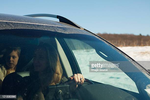 Mother and daughter driving in car
