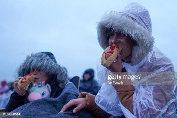 Mother and daughter eat hot dogs as they attend a screening of The Greatest Showman during the Luna Cinema movie experience at Castle Howard on...