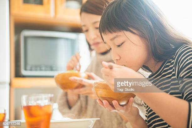 mother and daughter eating lunch together on holiday - 食事 ストックフォトと画像